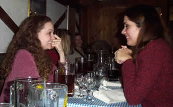 Foster and Demmert's sister laugh about something-or-other